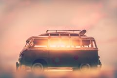 Campervan on sunset. Penetrating rays of the sun through the windows of the car, home on the wheels, active summer traveling on minivan royalty free stock images