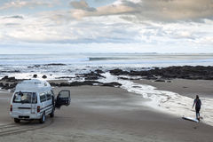 Campervan and surfer Stock Images