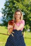 Campesina con el pollo Fotos de archivo