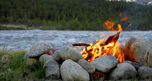 Campfire. Between stones in front of a river stock photos