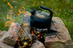 Campfire. Teapot on the campfire royalty free stock images
