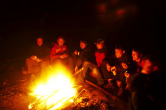 Campfire. People near campfire in forest royalty free stock photography
