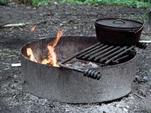 Campfire. A campfire in a ring with cooking grate Royalty Free Stock Images