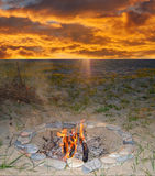 Campfire. In the evening. Sunset on background Royalty Free Stock Photo