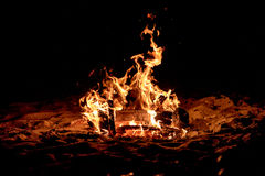 Campfire on the beach. Illuminating night royalty free stock photography