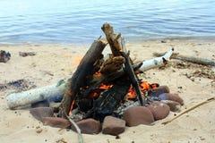 Campfire at the beach Royalty Free Stock Photos