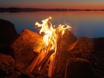 Campfire on the beach at night Royalty Free Stock Images