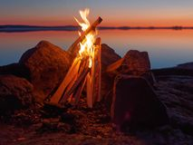 Campfire on the beach at night Stock Photos