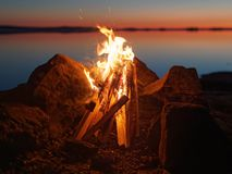 Campfire on the beach at night Stock Image