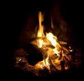 Campfire burning fire ash flames and coals closeup Stock Photos
