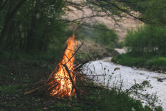 Campfire. Camp fire start near to the river Stock Photo