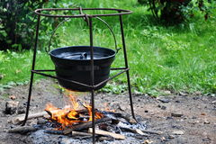 Campfire cooking in cauldron. Hungarian Goulash - tripod campfire cooking in cauldron Royalty Free Stock Photos