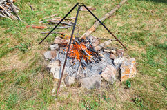 Campfire for cooking food at the outdoors in summer stock photography