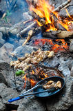 Campfire Cooking with Grill and Frying Pan Royalty Free Stock Photography