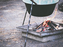 Campfire cooking. Preparing food in a campfire pot Stock Photo