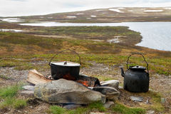 Campfire cooking in Swedish Lapland. Royalty Free Stock Image