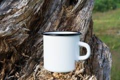 Campfire enamel mug mockup with stump royalty free stock images