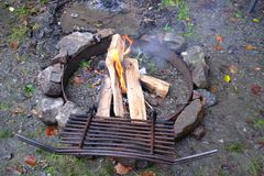 Campfire in the Evening. Campfire in a Fire Ring surrounded by Stones Royalty Free Stock Images