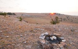 Campfire firepiit with food on it at sunrise in the Pryor mountains in Montana. United States Royalty Free Stock Photos