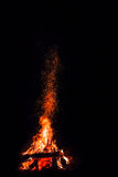 Campfire with flying sparks. Isolated on black background royalty free stock photo