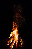 Campfire with flying sparks. Isolated on black background stock image