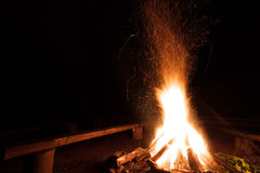 Campfire with flying sparks Royalty Free Stock Image