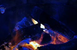 Campfire. Glowing campfire ready for roasting marshmallow s Royalty Free Stock Photo