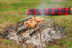 Campfire with grill and barbecue outdoor Royalty Free Stock Image