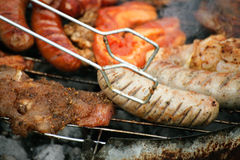 Campfire grilling steak sausage on the BBQ Royalty Free Stock Photos