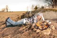 Campfire hiking woman sleep countryside. Campfire hiking woman with backpack sleep in countryside Stock Photos