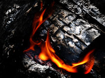 Campfire with Hot Coals. Hot coals and flames in buring campfire stock image