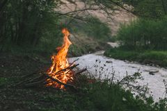 Campfire in nature, near to a river. Camp fire start near to the river in abeautiful nature Stock Image
