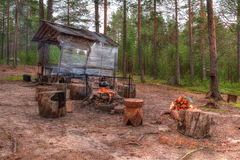 Campfire near gazebo in forest Royalty Free Stock Photo