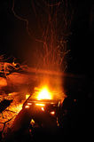 Campfire at Night. Sparks Rising from a Campfire at Nighttime Royalty Free Stock Photography