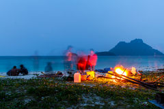 Campfire in night on the beach during the summer Stock Image
