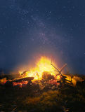 Campfire in the night. Bright campfire against the starry night sky royalty free stock image