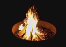 Campfire at night. A campfire in a simple firepit burning brightly at night royalty free stock photo