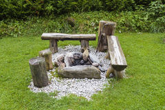 Campfire place. A place in the garden to make a campfire and sit around it Stock Image