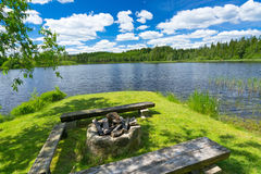 Campfire place on the lake coast Royalty Free Stock Image