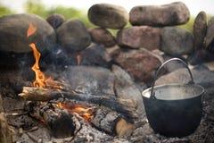 Campfire and pot Stock Photos
