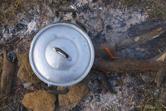 Campfire pot boiling. Preparing food on campfire in wild camping Stock Photography