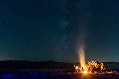 Campfire with a starry background Royalty Free Stock Photo