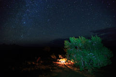 Campfire and stars in the Utah desert. Royalty Free Stock Photos