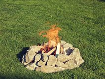 Campfire. In summer with beautiful green grass Stock Photography