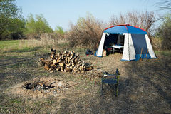Campfire and tent Stock Image