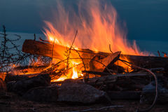 Campfire at twilight on beach Royalty Free Stock Image