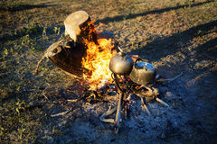 Campfire and two teapots Stock Photo