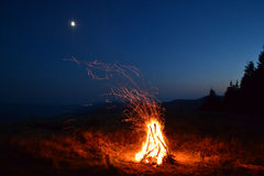 Campfire. Type of a beautiful fire in mountains and the sky, with calling and sunrise Stock Image