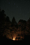 Campfire under starry sky Royalty Free Stock Image