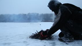Campfire in winter stock footage